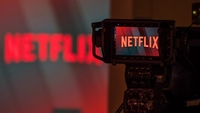 A television camera focuses on the Netflix logo in this arranged photograph in London on June 26, 2018. MUST CREDIT: Bloomberg photo by Chris Ratcliffe.