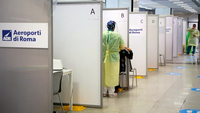 A health-care worker wearing personal protective equipment collects a swab sample from a passenger at the covid-19 rapid test facility at Fiumicino Airport in Rome on Sept. 25, 2020. MUST CREDIT: Bloomberg photo by Alessia Pierdomenico