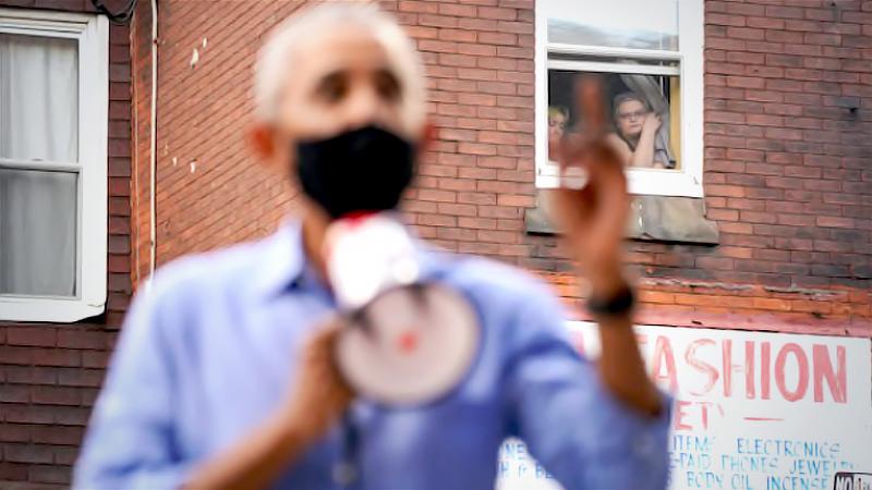 Women watch from a window as former president Barack Obama campaigns in Philadelphia on Wednesday for Democratic nominee Joe Biden. MUST CREDIT: Washington Post photo by Bonnie Jo Mount