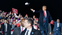 President Donald Trump throws hats to the crowd as he arrives for a campaign event at the Duluth International Airport on Sept. 30, in Duluth, Minn. MUST CREDIT: Washington Post photo by Jabin Botsford