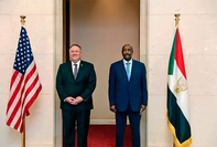 Secretary of State Mike Pompeo, left, stands with Sudanese Gen. Abdel-Fattah al-Burhan, head of the transitional military government, in Khartoum on Aug. 25. (Sudanese Cabinet/ AP)