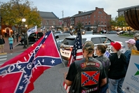 Supporters of President Trump gather as a Gettysburg police cruiser goes by on the square in Gettysburg, Pa., on Oct. 10.  Washington Post photo by Michael S. Williamson.