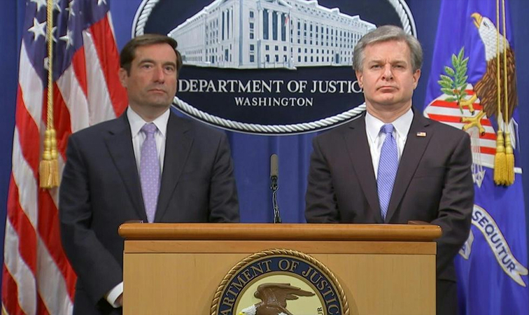 Assistant Attorney General John C. Demers, left, and FBI Director Christopher A. Wray on Wednesday.