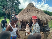 Friends from Thailand (FFT) volunteer Sompong Woragool helps farmers in Tuane, Mozambique, catch and raise rabbits in traditional cages.