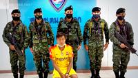 An arrested Myanmar national.