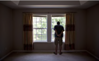 A prospective home buyer looks out the master bedroom window at a house for sale in Dunlap, Ill, on Aug. 19, 2018. MUST CREDIT: Bloomberg photo by Daniel Acker.
