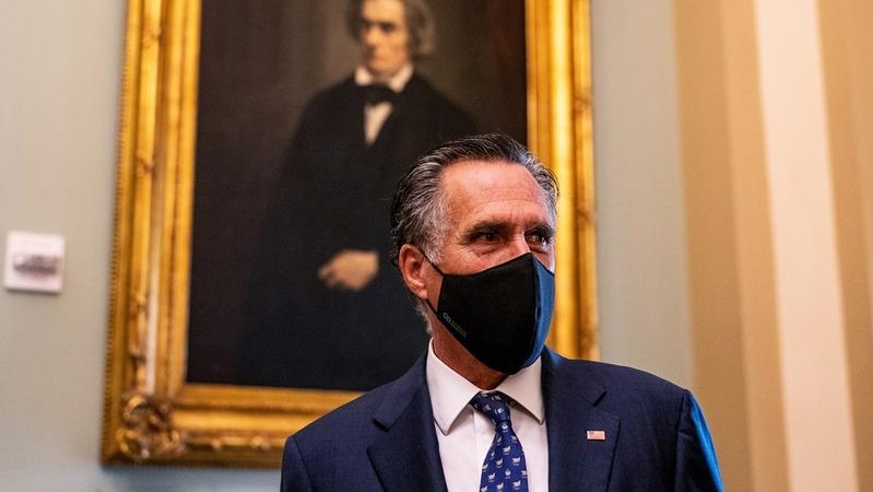 Sen. Mitt Romney speaks to reporters in the Capitol in September. MUST CREDIT: Washington Post photo by Demetrius Freeman