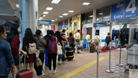 Tourists lining up at Chiang Mai International Airport