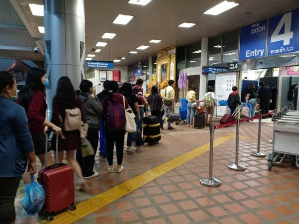 Tourists lining up at Chiang Mai International Airport