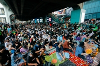 The Bad Student group rallies at BTS Siam Square on Saturday, ahead of the planned demonstration outside the Crown Property Bureau on Wednesday (November 25).