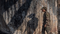 A U.S. soldier walks past a wall burned in the Iranian airstrike at the Ain Al-Asad base near Anbar, Iraq, on January 13, 2019. MUST CREDIT: Photo for The Washington Post by Emilienne Malfatto