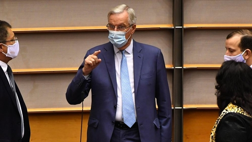 Michel Barnier, chief negotiator for the European Union, center, wears a protective face mask while speaking with lawmakers ahead of a State of the Union address in the European Parliament in Brussels on Sept. 16, 2020. MUST CREDIT: Bloomberg photo by Geert Vanden Wijngaert.