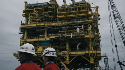 Employee pass in front of the finished Abkatun-A2 oil platform at the Mcdermott International Inc. fabrication facility in Altamira, Mexico, on Nov. 2, 2018. MUST CREDIT: Bloomberg photo by Luis Antonio Rojas.