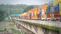 A file photo shows cargo trucks lined up on the bridge over Mechi River. Post Photo