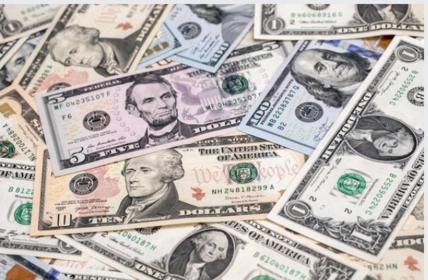 U.S. one-hundred dollar, ten-dollar, five-dollar and one-dollar bills. MUST CREDIT: Bloomberg photo by Paul Yeung. Photo by: Paul Yeung — Bloomberg