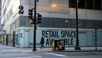 A pedestrian passes an available retail space in Chicago on May 7, 2020. MUST CREDIT: Bloomberg photo by Christopher Dilts.