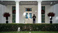 A Marine stands guard outside the West Wing as snow begins to fall at the White House on Wednesday, Dec 16, 2020 in Washington, D.C. MUST CREDIT: Washington Post photo by Jabin Botsford