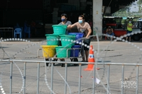 Thai authorities place a razor wire fence around Mahachai Market where a largest cluster of Covid-19 infections originated in Samut Sakhon province.