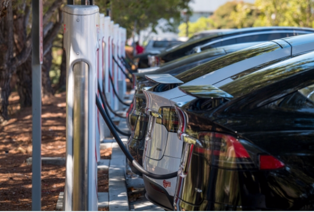 Tesla vehicles charge at a charging station in San Mateo, Calif., on Sept. 22, 2020. MUST CREDIT: Bloomberg photo by David Paul Morris.