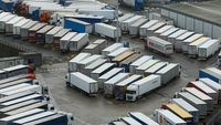 Trucks parked near the Port of Dover in Dover, England, on Dec. 22, 2020. MUST CREDIT: Bloomberg photo by Luke MacGregor