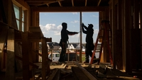 Construction workers install frames for windows and doors in a home being built in Bloomfield Hills, Mich., on May 7, 2020. MUST CREDIT: Bloomberg photo by Emily Elconin.