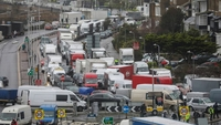 Trucks and vehicles sit in stationary traffic on the access road toward the Port of Dover in Dover, England, on Dec. 23, 2020. Routes to Dover, Britain's busiest cross-channel port, have been choked for days after France shut its border with Britain, blaming an outbreak of a novel strain of the coronavirus. MUST CREDIT: Bloomberg photo by Chris Ratcliffe