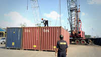 Batam Customs Office officers oversee the transfer of one of seven containers containing toxic and hazardous waste (B3 waste) to the Capricorn 97.210 Barge, on July 29, 2019 at the Batu Ampar Container Port, Batam, Riau Islands. (JP/Fadli)