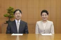 The Emperor and Empress face the camera to record their New Year messages for the public. (Courtesy of the Imperial Household Agency)