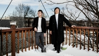 Zhou Fengsuo's colleague, Ouyang Ruoyu, left, has also had his posts censored on the app WeChat and supports a U.S. ban. MUST CREDIT: photo for The Washington Post by Bryan Anselm.