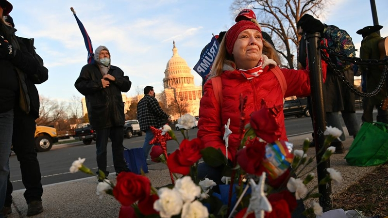 Melody Black cries on Thursday, Jan. 7, 2021, at a memorial for Ashli Babbitt outside the Capitol, where she was shot and killed in a riot the day before. MUST CREDIT: Washington Post photo by Matt McClain