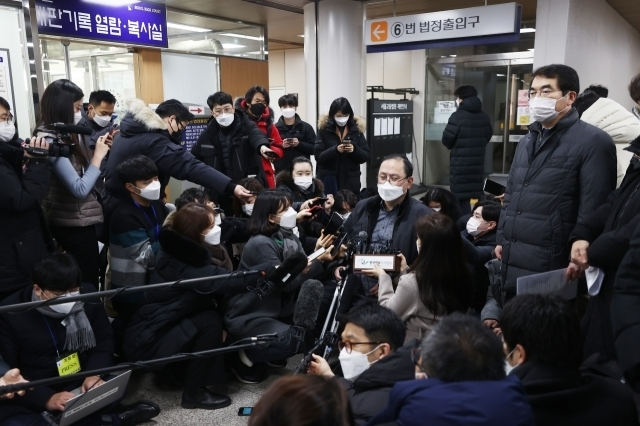 Attorney Kim Gang-won, who represents the so-called comfort women, answers reporters' questions after the court's ruling on Friday. (Yonhap)