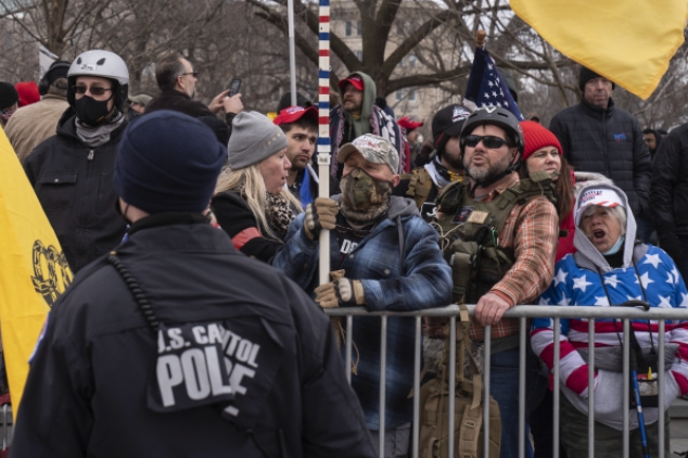 President Trump supporters stand on the east side of the U.S. Capitol on Jan. 6 before they stormed and breached the building to support the president's false and baseless claims that he won the election. MUST CREDIT: Washington Post photo by Michael Robinson Chavez.