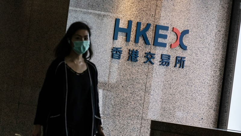 A person past signage for Hong Kong Exchanges & Clearing at the Exchange Square complex in Hong Kong on Aug. 19, 2020. MUST CREDIT: Bloomberg photo by Roy Liu.