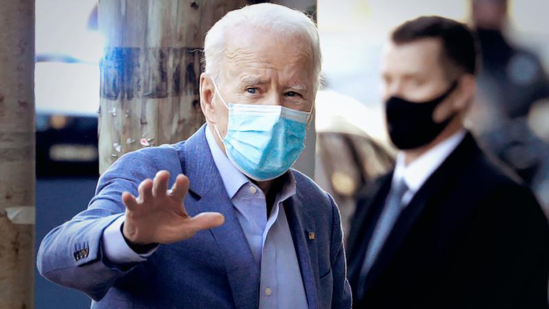 President-elect Joe Biden walks into the Queen theater in Wilmington, Del,, on Jan. 10. (Tom Brenner/ Reuters)