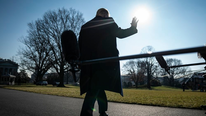 President Trump stops to talk to reporters as he walks to board Marine One and depart from the South Lawn on Tuesday. MUST CREDIT: Washington Post photo by Jabin Botsford