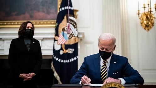 President Joe Biden signs executive orders at the White House on Friday, Jan 22, 2021. MUST CREDIT: Washington Post photo by Jabin Botsford