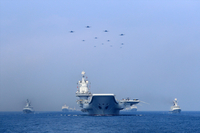 Warships and fighter jets of the Chinese People's Liberation Army (PLA) Navy take part in a military display in the South China Sea April 12, 2018. REUTERS/Stringer