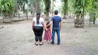 Antonio, Carolina and their daughter Mariel stand in front of the home of Carolina's parents in western Honduras. MUST CREDIT: Washington Post photo by Kevin Sieff