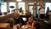 Diners eat indoors at the Sunrise Family Diner in Howell, Mich., on Jan. 18, 2021. MUST CREDIT: Photo by Ed Ou for The Washington Post