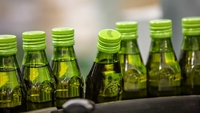 Bottles of olive oil move along the production line ahead of labeling at the Borges Agricultural & Industrial Edible Oils plant in Tarrega, Spain, on Dec. 5, 2019. MUST CREDIT: Bloomberg photo by Angel Garcia.