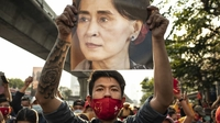 A demonstrator holds up an image of Aung San Suu Kyi during a protest outside the Embassy of Myanmar in Bangkok, Thailand, on Feb. 1 2021. MUST CREDIT: Bloomberg photo by Andre Malerba.