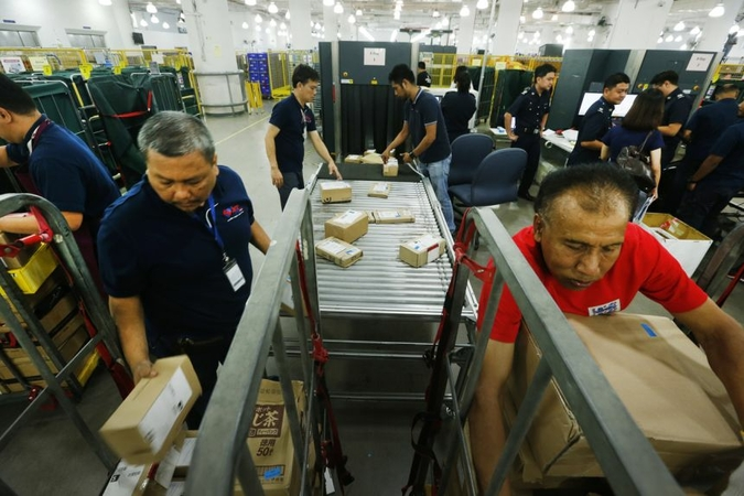 Low-value goods that are worth $400 or less and imported via air or post are currently not subject to GST. PHOTO: ST FILE