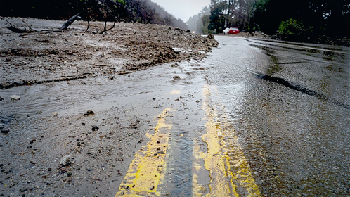 Excessive rainfall from storms along the Central California coast caused mudslides and rockfalls in vulnerable areas of the Dolan Wildfire burn scar area closing portions of Highway 1 in Big Sur, Calif., shown Jan. 28, 2021. More intense storms are causing havoc nationwide. 