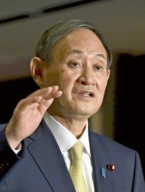 Prime Minister Yoshihide Suga speaks to reporters in Tokyo on Wednesday. (The Yomiuri Shimbun)