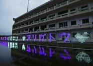 LED light bulbs form messages in front of a former Kesennuma Koyo High School building in Kesennuma, Miyagi Prefecture, on March 2. (The Yomiuri Shimbun)