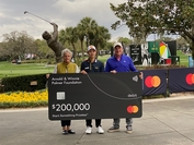 Jazz Janewattananond with a mock cheque after his hole in one. (Photo credit to PGA TOUR )
