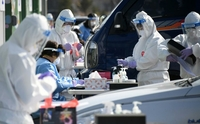 Tests for all villagers are under way at a drive-thru COVID-19 testing station in Jinbu of Pyeongchang, Gangwon Province, on Wednesday, as scores of Jinbu villagers tested positive for the virus, in this photo provided by Pyeongchang County. (Pyeongchang County)