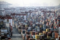 Shipping containers next to gantry cranes at the Yangshan Deepwater Port in Shanghai on Jan, 11, 2021. MUST CREDIT: Bloomberg photo by Qilai Shen.