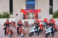 Thailand Post's first EV bike -- Benly-E (red) and PCX Electric (white).