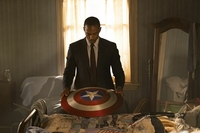 Sam Wilson (Anthony Mackie) looks down at the shield he inherited from Captain America in